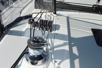 On the Catalina 309, the jib and spinnaker halyards, and line for the boom vang, all lead through stoppers to a self-tailing winch