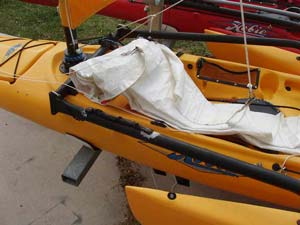 When I want to sail with the jib, I unroll the sheet lines and roll out the sail along the downwind side of the boat.