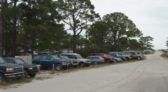 There were more cars on Dog Island -- junked out and rusting in the salt air -- than either people or buildings.