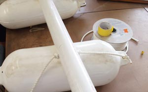 Lines are run through the PVC and tied to the bottom end of the fender
