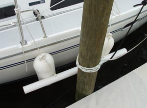 The completed fenderboards hanging on a Catalina 309 at the dock