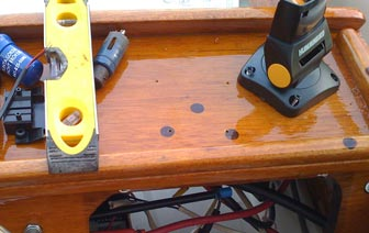 I drilled 4 holes in the console for the mounting base screws.