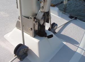 This picture shows how the MacGregor mast raising device is attached to the tabernacle mast base of the Precision 23. The plates used are actually a small boat hinged mast step available from Dwyer, and they happen to fit perfectly on the Precision 23 mast step, also from Dwyer Masts. One hole through the mast step on the 23 was all that was required to attach the unit.