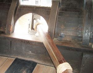 The large tiller swept a broad arc