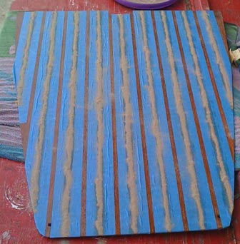 I put a thick coat of varnish on the holly strips, then took some sand and piled up a row of sand over each varnish strip.