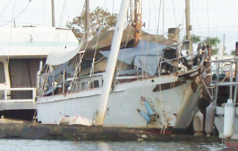 Sunken sailboat at the city marina