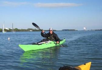 Guy In A Green Kayak